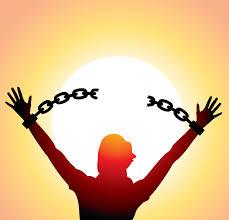 Man holding up broken chains
